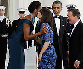 (L-R) First lady Michelle Obama, Samantha Cameron, U.S. President Barack Obama and British Prime Minister David Cameron greet one another on the North Portico of the White House March 14, 2012 in Washington, DC. Cameron is on a three-day visit to the U.S. and he was expected to have talks with Obama on the situations in Afghanistan, Syria and Iran. .Credit: Chip Somodevilla / Pool via CNP