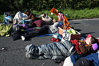 Pictured: Climate protesters have blocked access to the Valero refinery in Pembroke Dock, Wales, UK. Thursday 19 September 2019<br /> Re: Ten Extinction Rebellion climate change protesters have blocked three entrances of the Valero site in Pembroke Dock, Pembrokeshire, one of the biggest oil refineries in Europe.<br /> Protesters have attached themselves to wooden boxes filled with concrete in a bit to stop vehicles from entering or leaving the site.