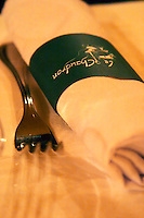 The restaurant Le Chaudron in Tournon: a table set with linen table cloth and wine glasses, napkins knives forks. Detail of napkin and fork. Tournon-sur-Rhone, Ardeche Ardèche, France, Europe