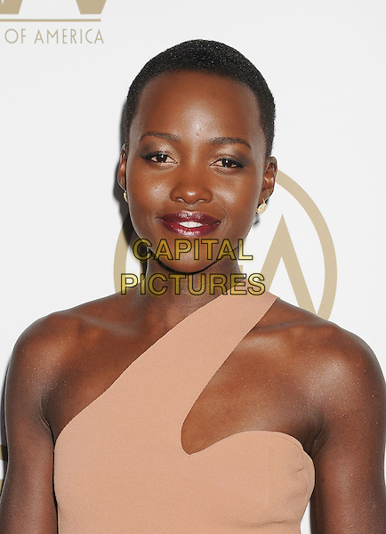 BEVERLY HILLS, CA- JANUARY 19: Actresses Lupita Nyong'o arrive at the 25th Annual Producers Guild Awards at The Beverly Hilton Hotel on January 19, 2014 in Beverly Hills, California.<br /> CAP/ROT/TM<br /> &copy;Tony Michaels/Roth Stock/Capital Pictures