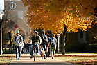 Students walk on the South Quad outside O'Shaughnessy classroom building on the University of Notre Dame campus.