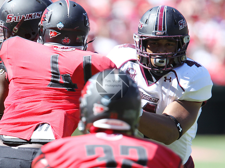 Southern Illinois Salukis tight end MyCole Pruitt (4) grapples with Redhawks defenders. The Southern Illinois University - Carbondale (SIUC) Salukis defeated the host Southeast Missouri State University (SEMO) Redhawks 36-19 in an NCAA football game at Busch Stadium on Saturday September 21, 2013.