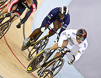 19 FEB 2012 - LONDON, GBR - Great Britain's Jason Kenny (GBR) (on right in white) leads the pack to the finish line during the Men's Sprint 5th to 8th place decider at the UCI Track Cycling World Cup, and London Prepares test event for the 2012 Olympic Games,  in the Olympic Park Velodrome in Stratford, London, Great Britain .{(PHOTO (C) 2012 NIGEL FARROW)