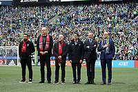SEATTLE, WA - NOVEMBER 10: Toronto FC legend Dwayne De Rosario, Toronto FC owners George Cope and Larry Tanenbaum, Seattle Sounders FC owner Adrian Hanauer, MLS Commissioner Don Garber, and Seattle Sounders FC legend Kasey Keller stand during the playing of the national anthems during a game between Toronto FC and Seattle Sounders FC at CenturyLink Field on November 10, 2019 in Seattle, Washington.