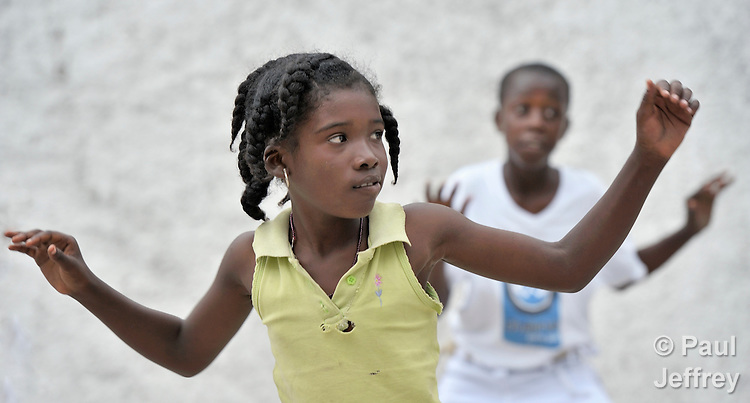 Children practice capoeira on January 24 in a camp for homeless families in the Belair section of Port-au-Prince. The program, run by Viva Rio, a Brazilian nongovernmental organization, is designed to help children affected by the quake recover their emotional well-being. The ACT Alliance is providing tents, water, psycho-social consultation and other support for families living here.