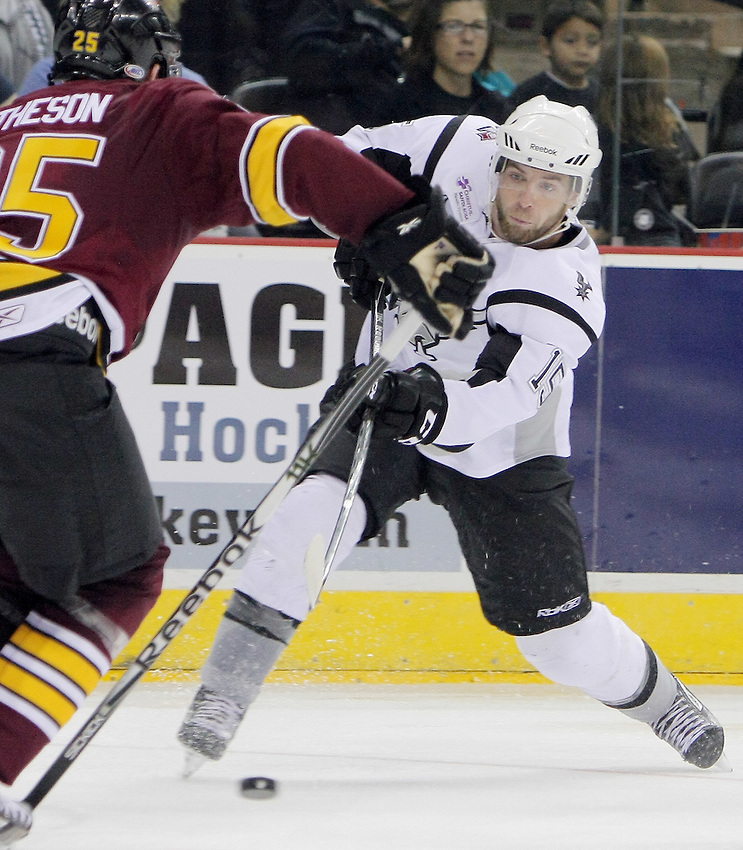San Antonio Rampage's Eric Selleck passes around Chicago Wolves' Mark Matheson during the second period of an AHL hockey game, Saturday, Oct. 8, 2011, in San Antonio. (Darren Abate/pressphotointl.com)
