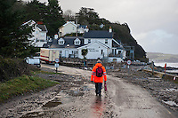 Friday 03 January 2014<br /> Pictured: The Road covered in stones and mud after the surge at Wisemans Bridge, Pembrokeshire<br /> Re: Storm force winds and some of the highest tides in decades hit Wales early on Friday.