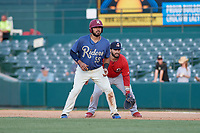 Frisco RoughRiders Tony Sanchez (55) leads off in front of first baseman Chris Chinea during a Texas League game against the Springfield Cardinals on May 5, 2019 at Dr Pepper Ballpark in Frisco, Texas.  (Mike Augustin/Four Seam Images)