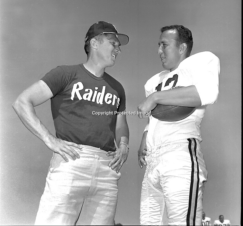 Oakland Raider coack Al Davis with quarterback Tom Flores at training camp 1963..(photo 1963/Ron Riesterer)