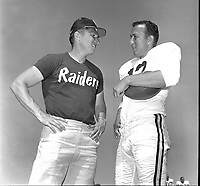 Oakland Raider coack Al Davis with quarterback Tom Flores at training camp 1963..(photo 1963/Ron Riesterer)