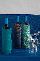 Bottles of local wine have been wrapped in fabric in art shades of blue