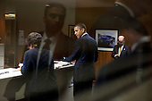 United States President Barack Obama is seen through a window backstage at the General Motors Lake Orion Assembly Plant in Orion Township, Michigan, October 14, 2011. .Mandatory Credit: Pete Souza - White House via CNP