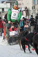 Kelly Maixner and team leave the ceremonial start line with an Iditarider at 4th Avenue and D Street in downtown Anchorage, Alaska on Saturday, March 5th during the 2016 Iditarod race. Photo by Joshua Borough/SchultzPhoto.com