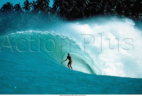 SURFING, Model Released, 9807. Photo: Icon/Action Plus....1998.surfing.surfer.surfers.water sport.water sports.watersport.watersports.model release.wave waves tube ride.splash splashes
