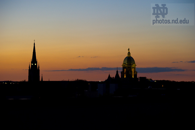 The Basilica of the Sacred Heart steeple and the Main Building at dusk...Photo by Matt Cashore/University of Notre Dame