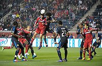 Chicago Fire defender Dan Gargan (3) heads a corner kick toward the goal while being pressured by Philadelphia Union defender Porfirio Lopez (24).  The Chicago Fire defeated the Philadelphia Union 1-0 at Toyota Park in Bridgeview, IL on March 24, 2012.