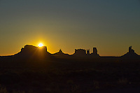 The sun rises over the spires and buttes of Monument Valley which straddles the borders of Arizona and Uath.