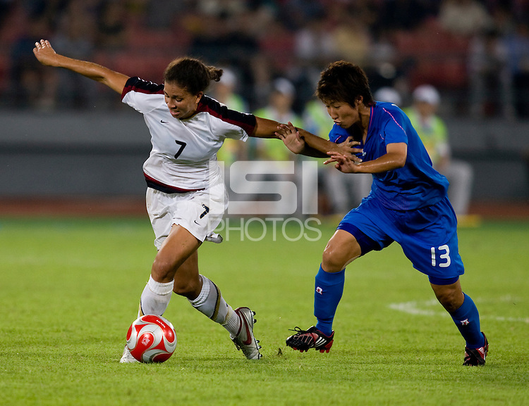 USWNT midfielder (7) Shannon Boxx pulls away from Japanese defender (13) Ayumi Hara while playing at Worker's Stadium.  The USWNT defeated Japan, 4-2, during the semi-finals of the Beijing 2008 Olympics in Beijing, China.