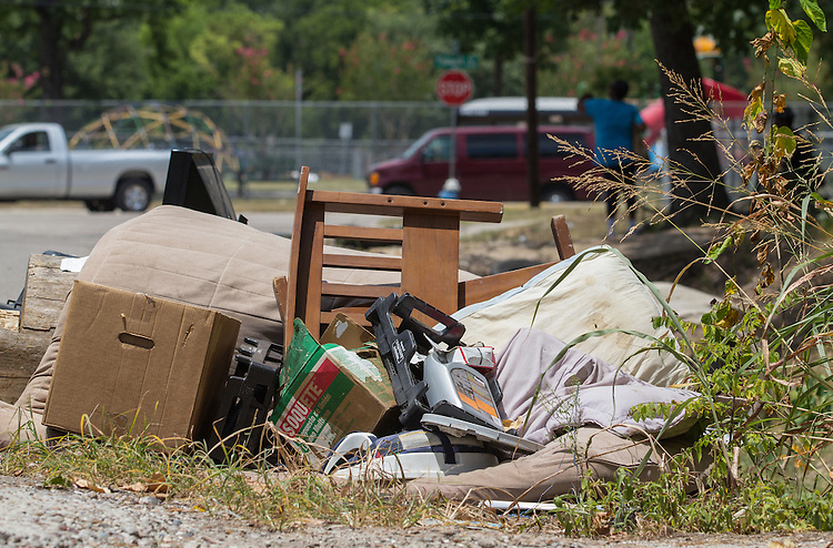 Furniture, bedding, boxes and other household items have been dumped on a sidewalk along Grady, leading toward Shadydale Elementary.