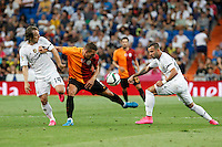 Real Madrid´s Modric and Carvajal and Galatasaray´s Lukas Podolski during Santiago Bernabeu Trophy match at Santiago Bernabeu stadium in Madrid, Spain. August 18, 2015. (ALTERPHOTOS/Victor Blanco)