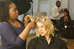 Backstage hair and makeup prep for the Murray West Fall Winter 2016 capsule collection fashion presentation by Jerrell West, in Contra Studios at 122 West 26 Street in New York City, on May 19, 2016.