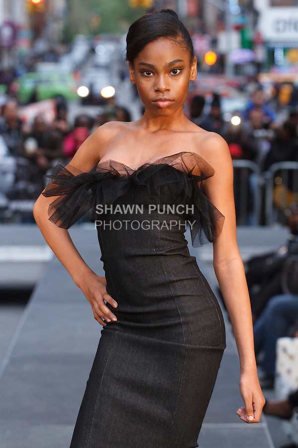 Model walks runway in an outfit from the Maxwell High School Fall 2016 collection, for the Young Designers Presentation during a Fashion Week Brooklyn 10th Anniversary fashion show at Willoughby Plaza on May 5, 2016.