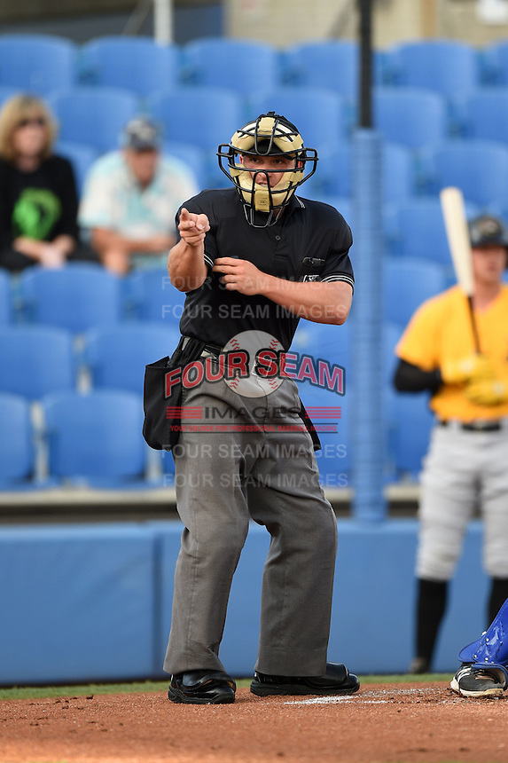 Umpire John Mang makes a call during a game between the Bradenton Marauders and Dunedin Blue Jays on April 14, 2015 at Florida Auto Exchange Stadium in Dunedin, Florida.  Bradenton defeated Dunedin 7-1.  (Mike Janes/Four Seam Images)