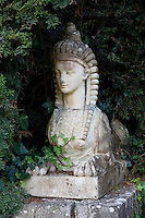 A sphinx bought by Lord Longford in 1780 guards the gateway to the kitchen garden