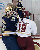 Peter Schneider (ND - 15), Ryan Fitzgerald (BC - 19) - The visiting University of Notre Dame Fighting Irish defeated the Boston College Eagles 7-2 on Friday, March 14, 2014, in the first game of their Hockey East quarterfinals matchup at Kelley Rink in Conte Forum in Chestnut Hill, Massachusetts.