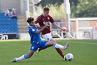 Courtney Senior of Colchester United stretches to rob Joe Bunney of Northampton Town of the ball during Colchester United vs Northampton Town, Sky Bet EFL League 2 Football at the JobServe Community Stadium on 24th August 2019