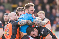 Picture by Allan McKenzie/SWpix.com - 11/03/2018 - Rugby League - Betfred Super League - Castleford Tigers v Salford Red Devils - the Mend A Hose Jungle, Castleford, England - Salford's George Griffin is tackled by Castleford's Nathan Massey & Grant Millington..