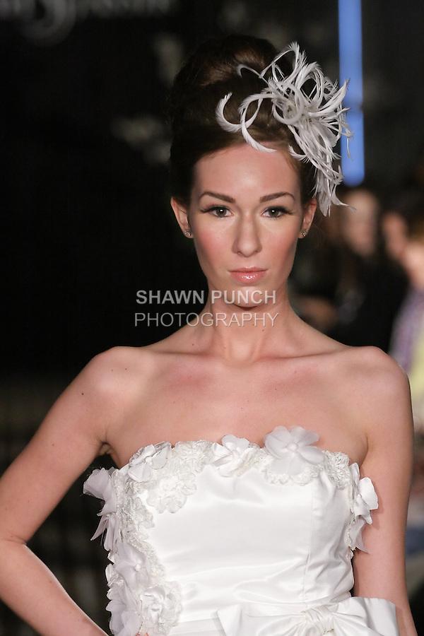 Model walks runway in an Adore wedding dress by Sarah Jassir, for the Sarah Jassir Fall 2011 - Desire bridal collection.