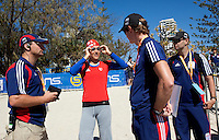11 SEP 2009 - SOUTHPORT, AUS - Hollie Avil talks with Mark Pearce (left) Ben Bright and Joel Filliol (right) before her U23 Womens race at the ITU World Championships (PHOTO (C) NIGEL FARROW)