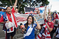 USA fans celebrate placing a USA head banner on a Guatemalan television announcer before the United States played Guatemala at Estadio Mateo Flores in Guatemala City, Guatemala in a World Cup Qualifier on Tue. June 12, 2012.