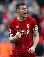 7th March 2020; Anfield, Liverpool, Merseyside, England; English Premier League Football, Liverpool versus AFC Bournemouth; James Milner of Liverpool celebrates in front of  supporters on the Kop as the match ends with a 2-1 Liverpool win