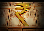 Golden Rupee symbol on Indian currency bundles