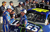 Feb 10, 2008; Daytona Beach, FL, USA; Nascar Sprint Cup Series driver Jimmie Johnson (right) talks with second place starter Michael Waltrip after winning the pole position during qualifying for the Daytona 500 at Daytona International Speedway. Mandatory Credit: Mark J. Rebilas-US PRESSWIRE