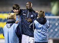Adebayo Akinfenwa of Wycombe Wanderers with the Millwall ballboys at halftime during the Checkatrade Trophy round two Southern Section match between Millwall and Wycombe Wanderers at The Den, London, England on the 7th December 2016. Photo by Liam McAvoy.