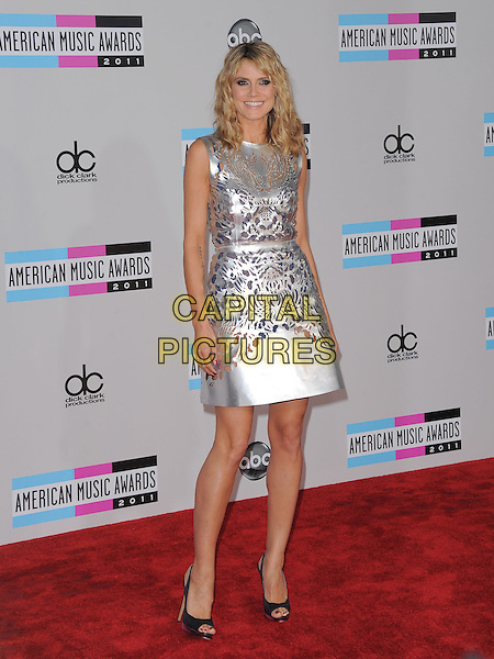 Heidi Klum.2011 American Music Awards held at The Nokia Theater Live in Los Angeles, California, USA..November 20th, 2011.AMA AMAS AMA's full length silver sleeveless silk satin perforated dress cut out away pattern open toe shoes black.CAP/RKE/DVS.©DVS/RockinExposures/Capital Pictures.