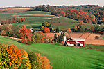 Amid the rolling hills, fall color surrounds farms in Walnut Creek, a town along a scenic route in Ohio.