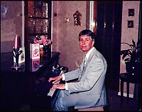 BNPS.co.uk (01202 558833)<br /> Pic: HattieMiles/BNPS<br /> <br /> Paul Barrett in 1968 playing his mothers piano.<br /> <br /> A retired businessman has spent £26,000 laying on his very own a show in tribute to his hero - the musical maestro Annunzio Paolo Mantovani.<br /> <br /> Paul Barrett, 72, will perform in a 48-piece orchestra he has hired for the performance that he is prepared to make a loss of thousands of pounds on.<br /> <br /> Mr Barrett said he plans to do 'everything bar conducting' in the musical extravaganza being hosted at the Bournemouth Pavilion Theatre in Dorset.
