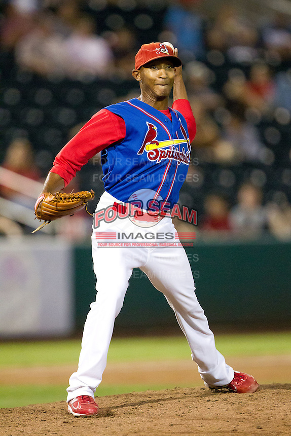 Samuel Freeman (12) of the Springfield Cardinals throws a pick off attempt to first during a game against the Corpus Christi Hooks at Hammons Field on August 13, 2011 in Springfield, Missouri. Springfield defeated Corpus Christi 8-7. (David Welker / Four Seam Images)