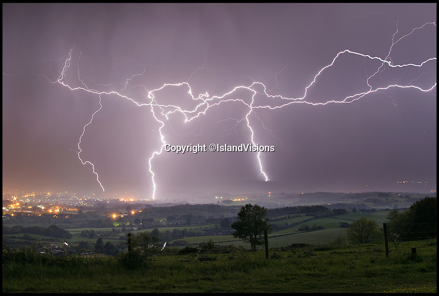 BNPS.co.uk (01202 558833)<br /> Pic: IslandVisions/BNPS<br /> <br /> ***Must use full byline***<br /> <br /> Storm over Sandown Bay taken from Brading Down on the Isle of Wight captured by photographer Jamie Russell (36) from Shanklin, Isle of Wight.<br /> <br /> The dramatic weather conditions formed as warm air clashed with a cold front moving in over the country.The storms marked the end of a mini heatwave which culminated in the hottest day of the year so far yesterday (Mon) with temperatures hitting a sultry 26 degrees in the south east.