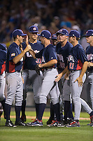 Tommy DeJuneas (29) of the US Collegiate National Team is congratulated by his teammates after closing out the game against the Cuban National Team at BB&T BallPark on July 4, 2015 in Charlotte, North Carolina.  The United State Collegiate National Team defeated the Cuban National Team 11-1.  (Brian Westerholt/Four Seam Images)