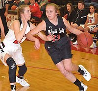 RICK PECK/SPECIAL TO MCDONALD COUNTY PRESS<br /> McDonald County's Kristin Penn drives past Aurora's Elizabeth Martin during the Lady Mustangs' 37-32 loss on Jan. 4 at Aurora High School.