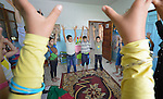 A group of children stretch their arms overhead during an activity at the Youth Empowerment Center in Beit Hanoun, Gaza. The program is supported by Caritas and DanChurchAid, a member of the ACT Alliance, and is designed to help children better cope with the trauma they experienced during the 2014 war.<br />