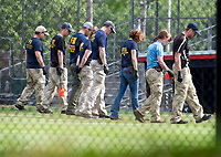 Evidence technicians from the FBI comb through the crime scene for evidence after a gunman opened fire on members of Congress who were practicing for the annual Congressional baseball game in Alexandria, Virginia on Wednesday, June 14, 2017.<br /> Credit: Ron Sachs / CNP/MediaPunch<br /> (RESTRICTION: NO New York or New Jersey Newspapers or newspapers within a 75 mile radius of New York City)