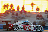 Fans watch the action at sunrise during the Rolex 24 at Daytona , Daytona International Speedway, Daytona Beach, FL, January 2009.  )Photo by Brian Cleary)