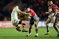 Lewis Boyce of Harlequins fends Thomas Young of Wasps. European Rugby Champions Cup match, between Harlequins and Wasps on January 13, 2018 at the Twickenham Stoop in London, England. Photo by: Patrick Khachfe / JMP
