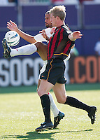 C.J. Brown of the Fire battles unsuccessfully to keep the MetroStars' John Wolyniec from the pass from Craig Ziadie moments before Wolyniec scores in the 28 minute. The Chicago Fire defeated the NY/NJ MetroStars 2-1 on 8/24/03 at Giant's Stadium, NJ..